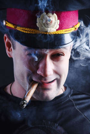cigare: Man with cigare and military cap