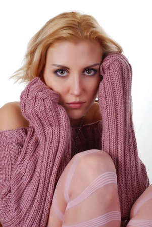 portrait of a beautiful blond woman in sweater photo