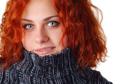 portrait of a beautiful woman with red hair in a sweater Stock Photo - 4265011