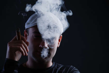 cigare: Man with cigare at black background