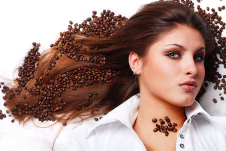 coffee beans on the hair of beautiful young woman