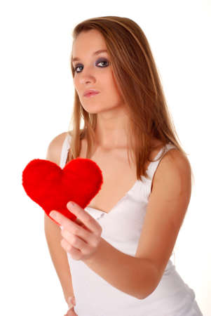 young beatiful woman holding artificial red heart photo