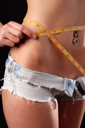 waist of young woman with tape measure photo