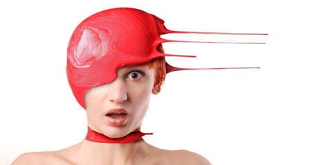 Splash of red paint on shocked womans head Stock Photo