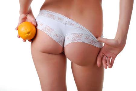 white panties: weibliche Ges�� in wei� und orange H�schen in der Hand