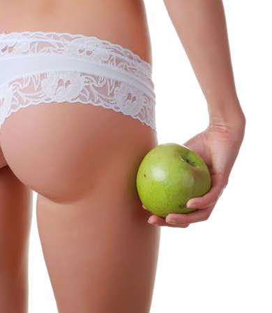 white panties: weibliche Ges�� in wei�en H�schen und Apfel in der Hand