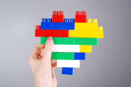 female hand with toy heart from construction set Stock Photo - 4823994