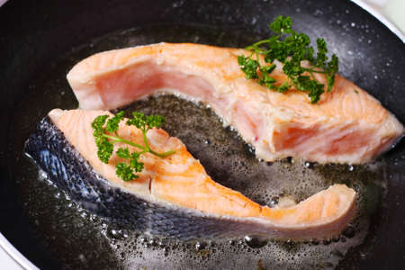 fresh slice of salmon in the frying pan  photo