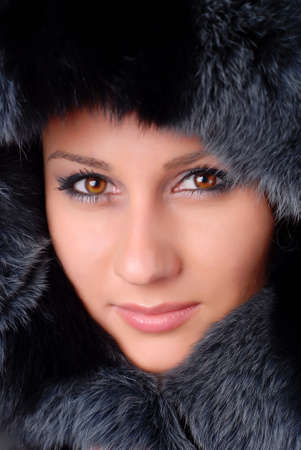 face of a beautiful woman in black fur  photo
