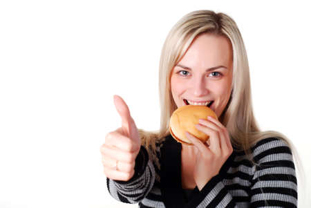 young woman with fresh hamburger at white background photo