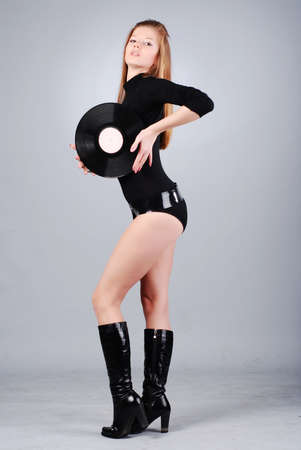 portrait of young beautiful woman with record photo
