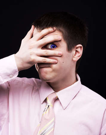 preoccupation: funny man in pink shirt at black background Stock Photo