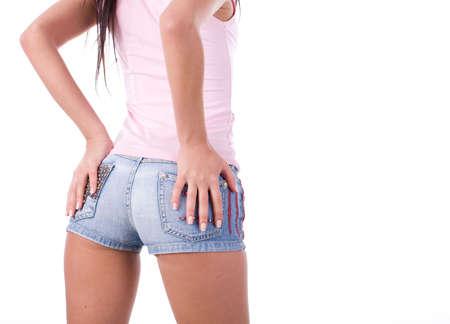 hermosas nalgas de la mujer joven en pantalones cortos azul Foto de archivo - 5879687
