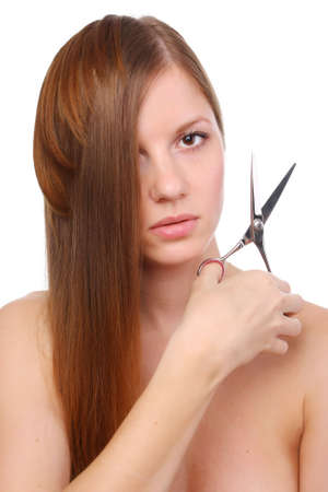 woman with long hair and scissors in her hands  photo