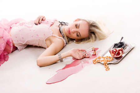 drunk luxurious blond woman in pink dress with silver tray photo