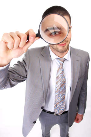 portrait of a young business man with magnifying glass photo