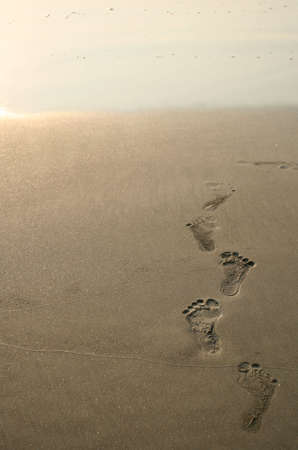 human footprints on the sand of the beach Stock Photo