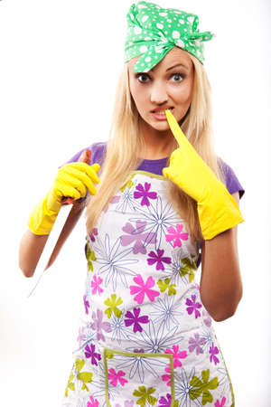 young beautiful housewife in rubber yellow gloves with knife  Stock Photo - 8246503