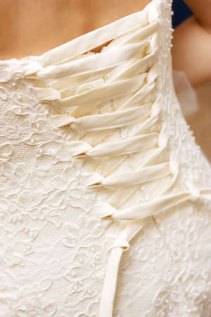 brides back in wedding white dress with lace Stock Photo - 8317861