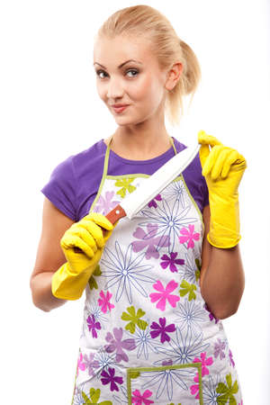 young beautiful housewife in rubber yellow gloves with knife  Stock Photo - 8318030