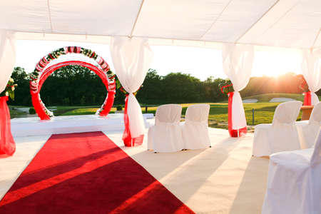 visiting ceremony with white decoration and red carpet