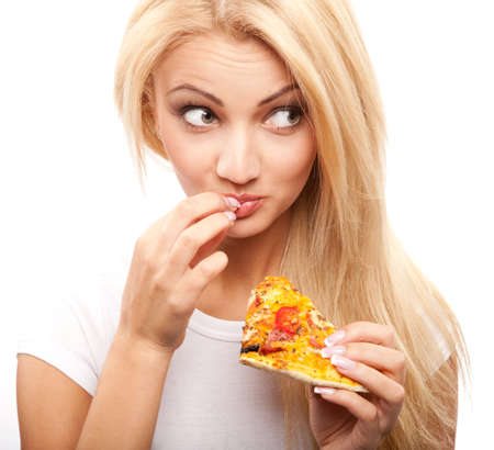 young beautiful blond woman eatting piece of pizza   photo