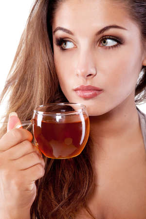 Woman with cup of fresh tasty black tea photo