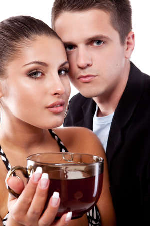 Young couple of man and woman drinking tea photo
