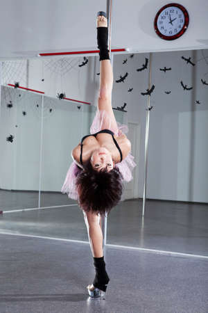 Young athletic woman dancing around the pole Stock Photo - 10086947