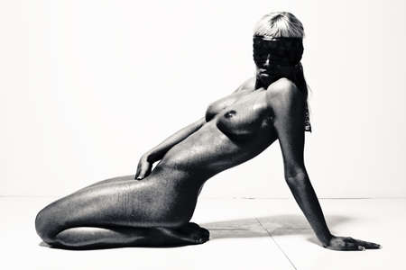 beautiful naked woman with black mask on her face