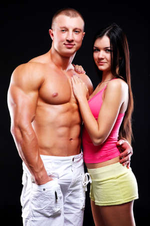 Couple of young woman and man with good bodies photo