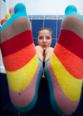 Crazy girl in bathroom weared in color striped socks Stock Photo - 11011975