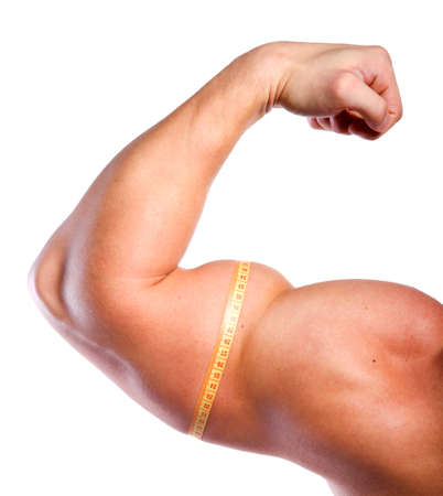 Strong hand with big biceps and centimeter of athlete photo