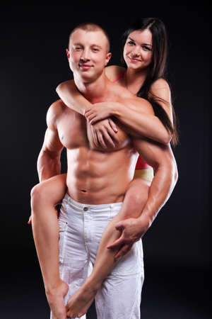 muscular man: Couple of young woman and man with good bodies