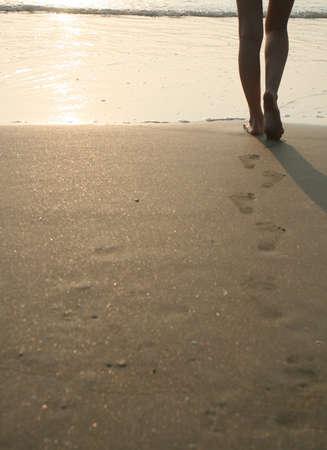 Footprints of woman on the sand on beach photo