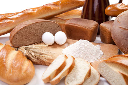 Fresh bread bakery products with eggs and flour on the breadboard Stock Photo - 13316753