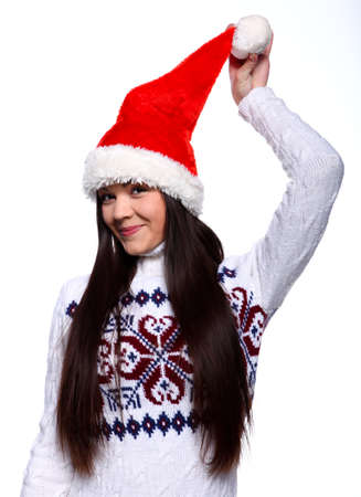 Smiling young woman in red christmass hat at white background Stock Photo - 13314986