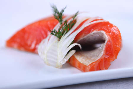Raw fresh red salmon at white plate photo