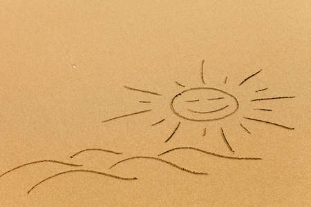 Simple drawing of sun and waves in the sand of the beach photo