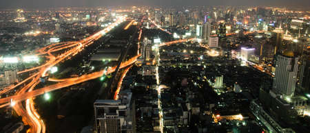 Night a big modern city with highways, top view photo