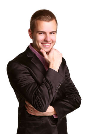 Young handsome man in black business suit. Hands under his chin Stock Photo - 14151227