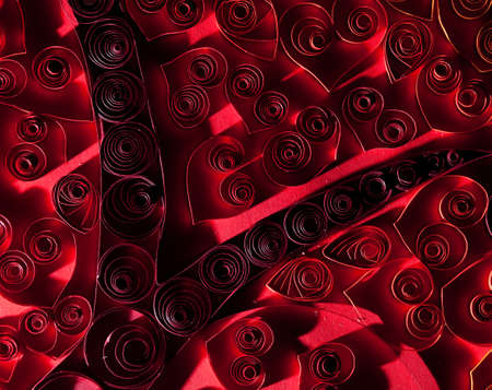 Quilling. Beautiful red hearts made ​​of twisted paper. photo