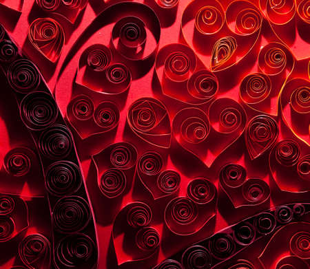 Quilling. Pretty red hearts made ​​of twisted paper. photo