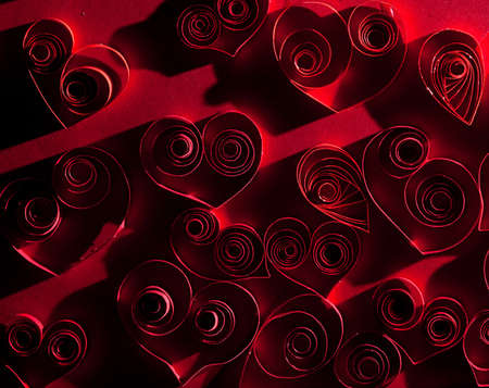 Quilling. Very beautiful red hearts made ​​of twisted paper. photo