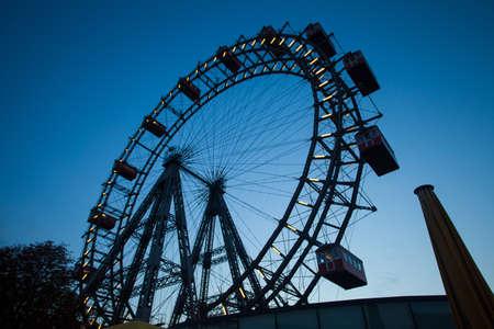 Big  ferris wheel city park in the evening park photo