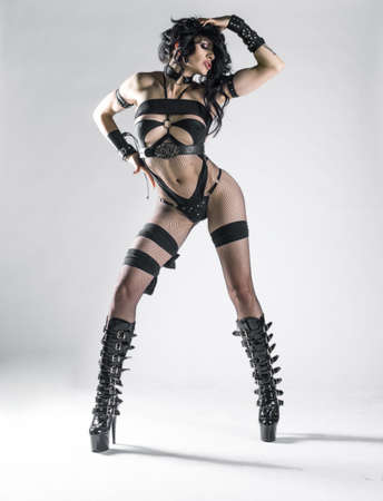 Beautiful dominant brunette vamp mistress girl Stock Photo