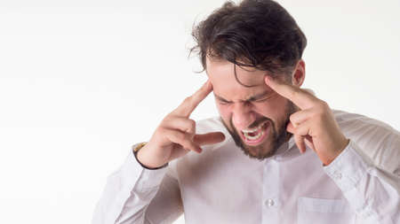 Crisis concept: Overburdened businessman closed eyes with both hands at head and shouting isolated on white background. Stock Photo