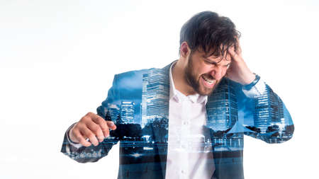Double exposition. megapolis. Young man in suit touching his head and keeping eyes closed while standing against white background. Stock Photo