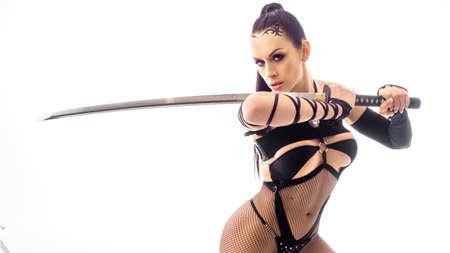 sexy woman with katana sword. Cosplay.