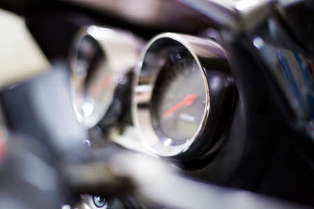 blurred motorbike control panel with speedometer